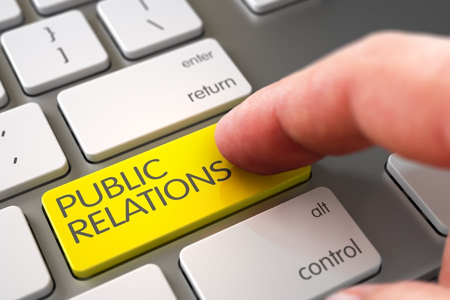 Hand Touching Public Relations Button.