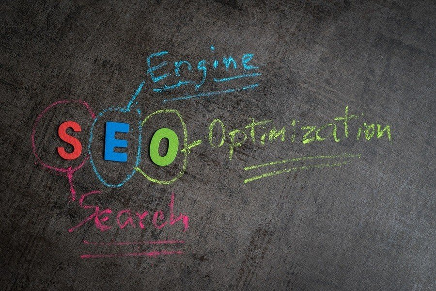 Search engine optimization, SEO ranking concept as colorful alphabet SEO, hand write explanation with color chalk on chalkboard wall