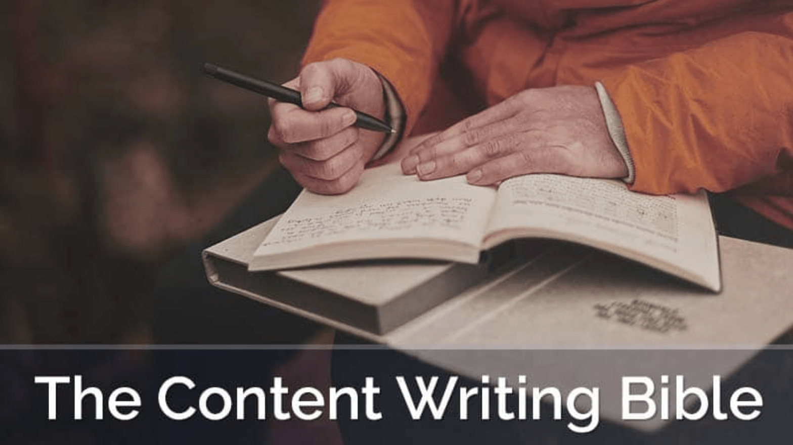 Content writer using a journal to take some notes with a pen